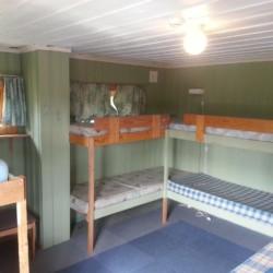 Schlafzimmer im Gruppenhaus in Norwegen am See in der Nähe von Oslo mit Namen Blestölen.