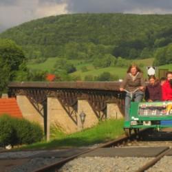 Draisinefahren beim deutschen Haus Hainichen für Menschen mit Behinderung.