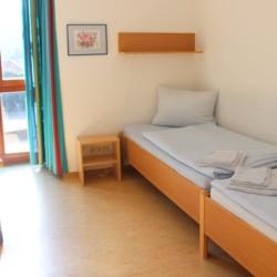 Ein Schlafzimmer im Freizeithaus Gästehaus Harz in Deutschland.