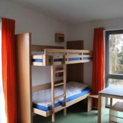 Ein Mehrbettzimmer im Freizeitheim Krekel für Kinder und Jugendfreizeiten in Deutschland.