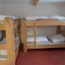 Ein Zimmer im Freizeitheim Waldmichl in Deutschland.