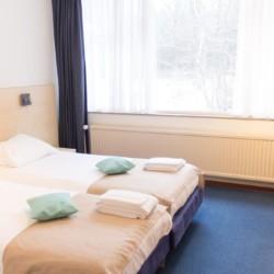 Ein Standard Zimmer im Gruppenhaus Fredeshiem in den Niederlanden.