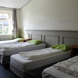 Das Vierbettzimmer im handicapgerechten niederländischen Gruppenhaus Hoeve/Schuurherd für Menschen mit Behinderung.