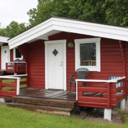 Blockhütten am schwedischen Gruppenhaus Flahult Ungdomsgård für Kinder und Jugendfreizeiten.