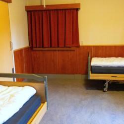Schlafzimmer für behinderte Menschen im Gruppenhaus ImminkOpkamer in den Niederlanden