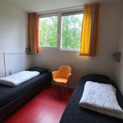 Ein Schlafzimmer im niederländischen Gruppenhaus De Jorishoeve.